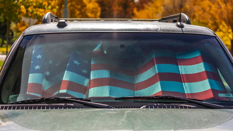 Funny car windshield sun shade. Be creative while keeping the car cool.