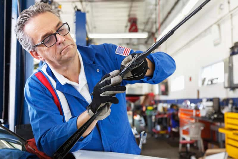 Instructions for removing and re-installing windshield wipers. Learn how to change them easily.