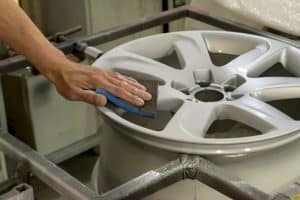 Removing corrosion from aluminum wheels.