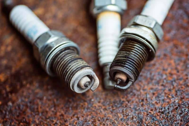 What are the reasons for oil on spark plugs and hot to fix the problem.