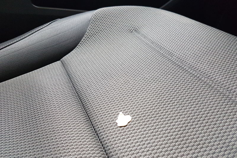 How to get a chewing gum off leather or fabric car seats.