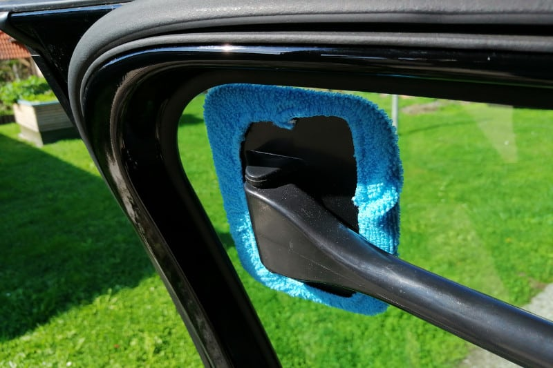 Window cleaner tool with a detachable handle and microfiber towel.
