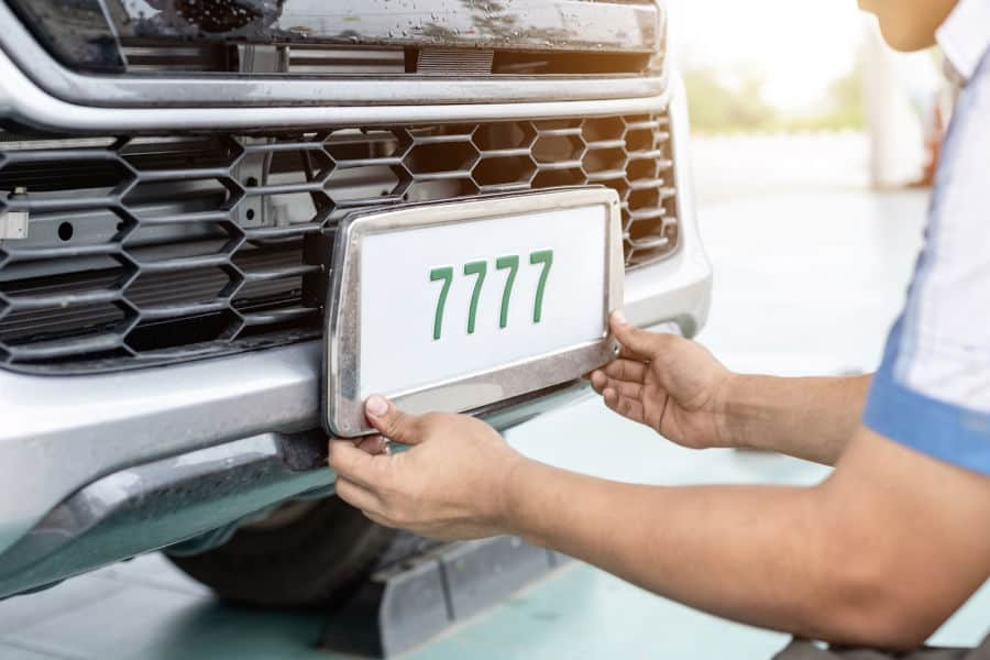 How do you transfer license plates from one car to another.