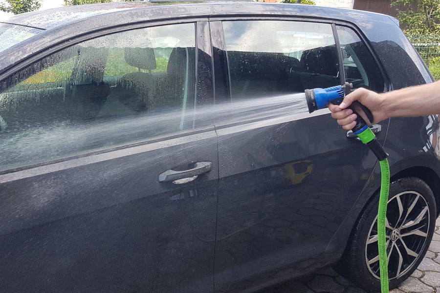 Cleaning car with a sprayer nozzle.