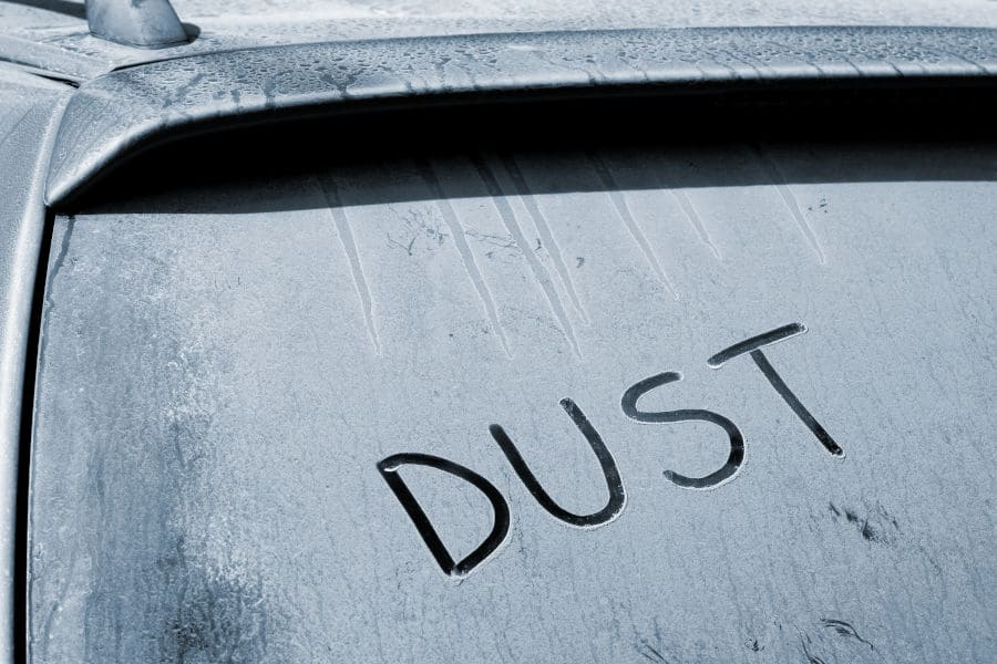 Dust on the surface of a car.