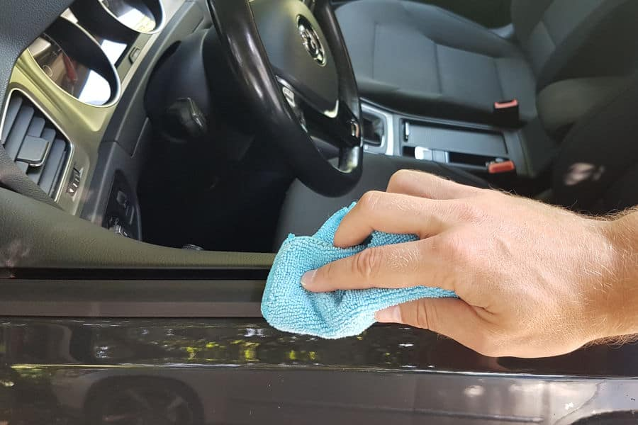How to clean and restore black rubber trim around car windows.