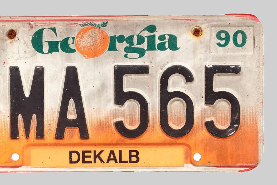 Rusted screws on license plate.