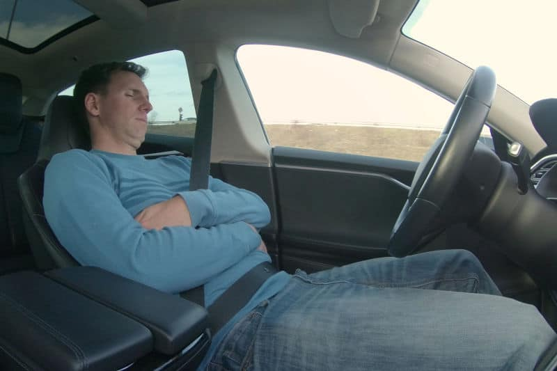 Sleeping in a car with the windows rolled up.